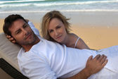 Couple relaxing on a deckchair — Stock Photo