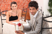 Guy inviting his belle to restaurant — Stock Photo