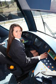 Female tram conductor sat at controls — Stock Photo