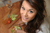 Pretty girl cooking, top view — Stock Photo