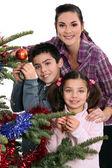 Family celebrating Christmas together — Stock Photo