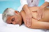Man in massage parlor — Stock Photo