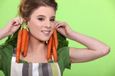Woman with bunches of carrots — Stock Photo