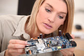 Woman repairing pc — Stock Photo