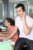 Young workers in office — Stock Photo
