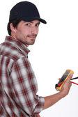 Tradesman holding a multimeter — Stock Photo