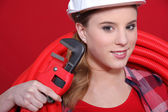 Woman with wrench — Stock Photo