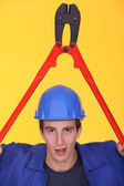 Man holding bolt-cutter over his head — Stock Photo