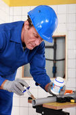 Skilled technician repairing canalizations — Stock Photo