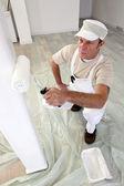 Tradesman painting a column — Stock Photo