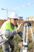 Surveyor on a construction site — Stock Photo