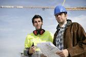 A surveyor and a traffic warden — Stock Photo