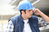 Builder on the phone — Stock Photo