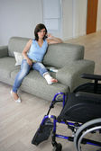 Woman with her leg in a cast — Stock Photo