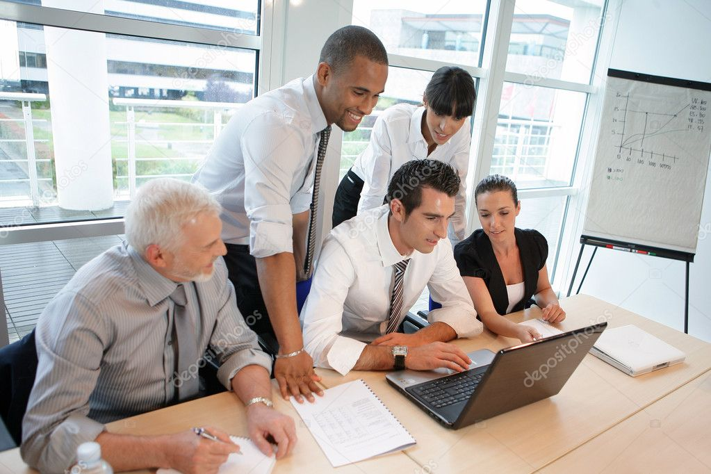 Business team looking at financial report on-line — Stock Photo #8556755