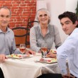 Family meal out in a restaurant - Stock Photo