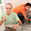 Stock Photo: Father and son assembling furniture