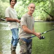 Senior and junior angling — Foto de Stock
