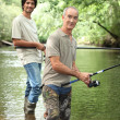 Senior and junior angling — Stock Photo