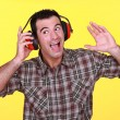 Man wearing earmuffs - Stock Photo