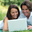 Couple in front of a laptop — Stock Photo