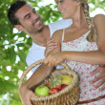 Couple with fruit basket — Stock Photo