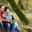 Couple sitting in woods — Stock Photo