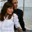 Couple on a terrace looking away — Stock Photo #8567568