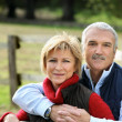 Couple hugging next to fence — Stock Photo #8567573