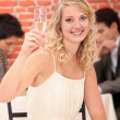 Blonde woman with a glass of white wine — Stock Photo #8568310