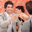 Friends having a celebratory drink — Stock Photo