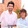 Homosexual couple celebrating event at restaurant — Stock Photo #8568447