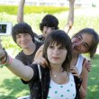 Stock Photo: Teens photographing