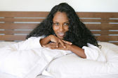 Woman lying on pillows — Stock Photo