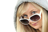 Blonde woman in large white sunglasses and a hooded fleece — Stock Photo