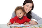 Woman and child colouring — Stock Photo