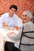Woman enjoying a meal out with her grandson — Stock Photo