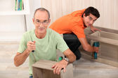 Father and son assembling furniture — Stock Photo