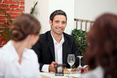 Handsome man in a restaurant — Stock Photo