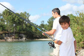 Father and son fishing together in the summertime — Stock Photo