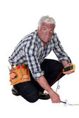 Electrician checking the voltage and getting a shock — Stock Photo