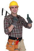 Builder holding calipers and giving the thumbs-up — Stock Photo