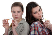 Teenagers smoking and breaking the habit — Stock Photo