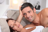 A man looking a wife sleeping deeply — Stock Photo