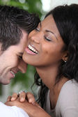 Young couple laughing intimately — Stock Photo