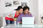 Couple having fun on Internet — Stock Photo