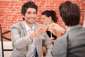 Friends having a celebratory drink — Stock Photo