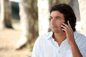 A man at phone in nature — Stock Photo