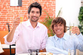Homosexual couple celebrating event at restaurant — Stock Photo
