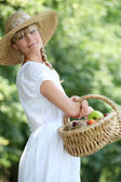 Fair-haired belle with basket — Stock Photo
